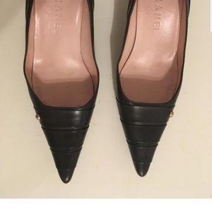 Chanel dark brown leather kitten pump.